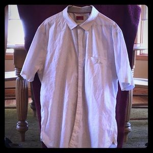 Short sleeved button down shirt.